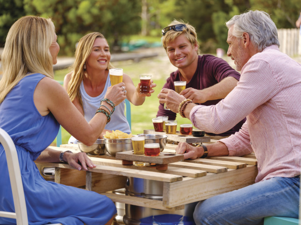 An image of a group of people enjoying beer to show brews and views and food and drink experiences on The South West Edge road trip